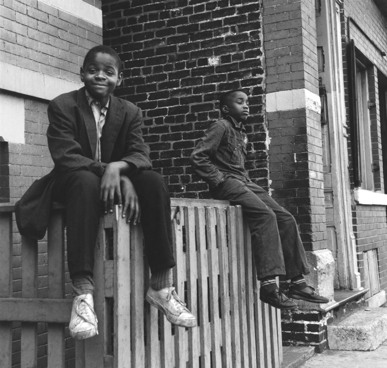 Boys Sitting on Picket Fence , 1955-65  Gelatin silver photograph.  7 1/4 x 7 5/8 inches