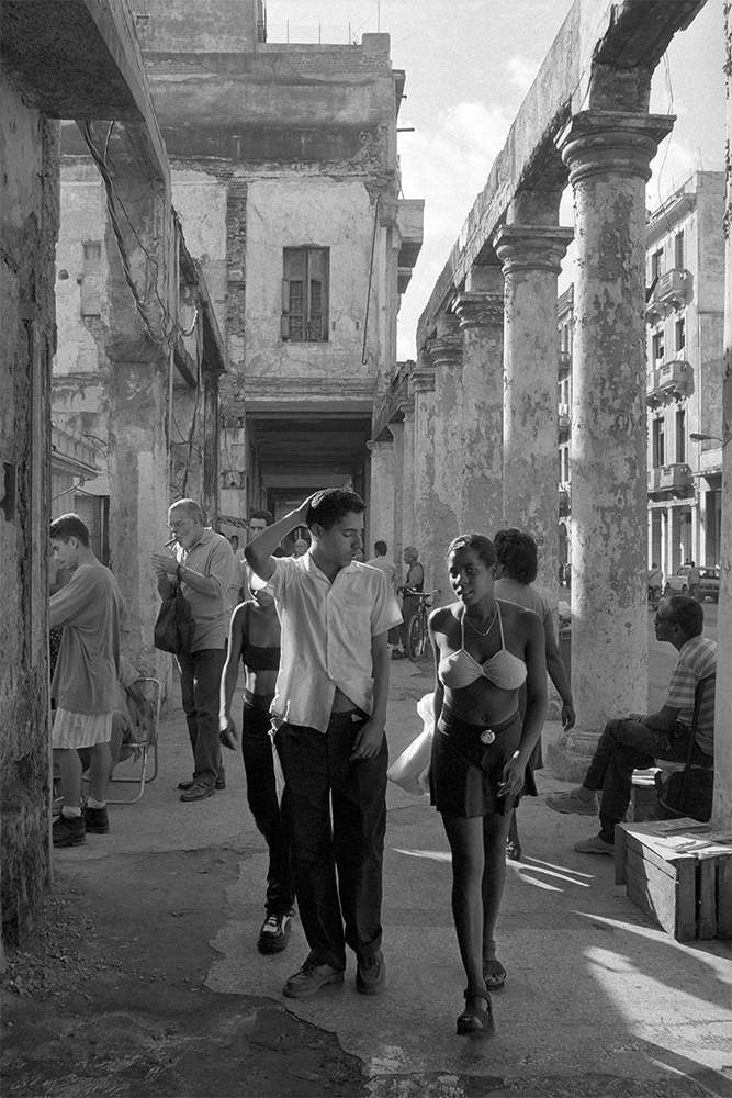 Boy Looking at Girl's Halter , Havana, Cuba, 1999  Archival pigment print.  20 x 13 3/8 inches