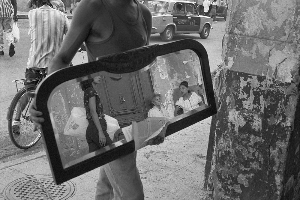 Man with the Mirror , Havana, Cuba, 1999  Archival pigment print.  13 3/8 x 20 inches