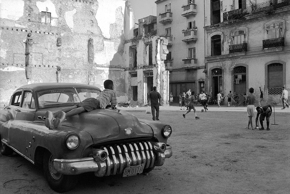 "Boy Watching Kickball Game , Havana, Cuba, 1999  Archival Inkjet Print  13 3/8 x 20"" $800"