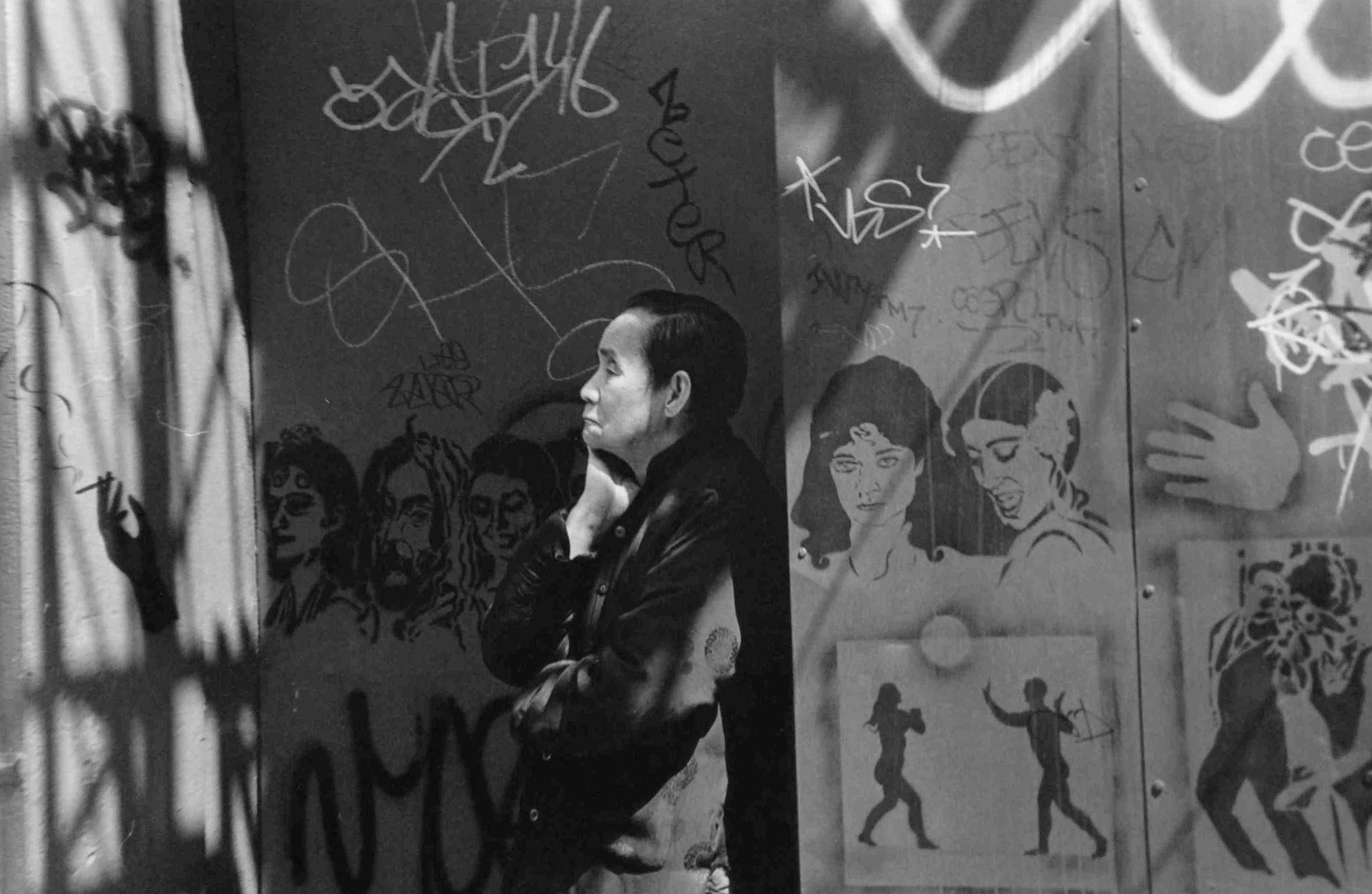 "Woman on Mott Street with Graffiti, New York , 1995  Archival Inkjet Print  20 x 13 3/8"" $800"