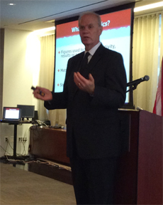 Dennis presenting.jpg