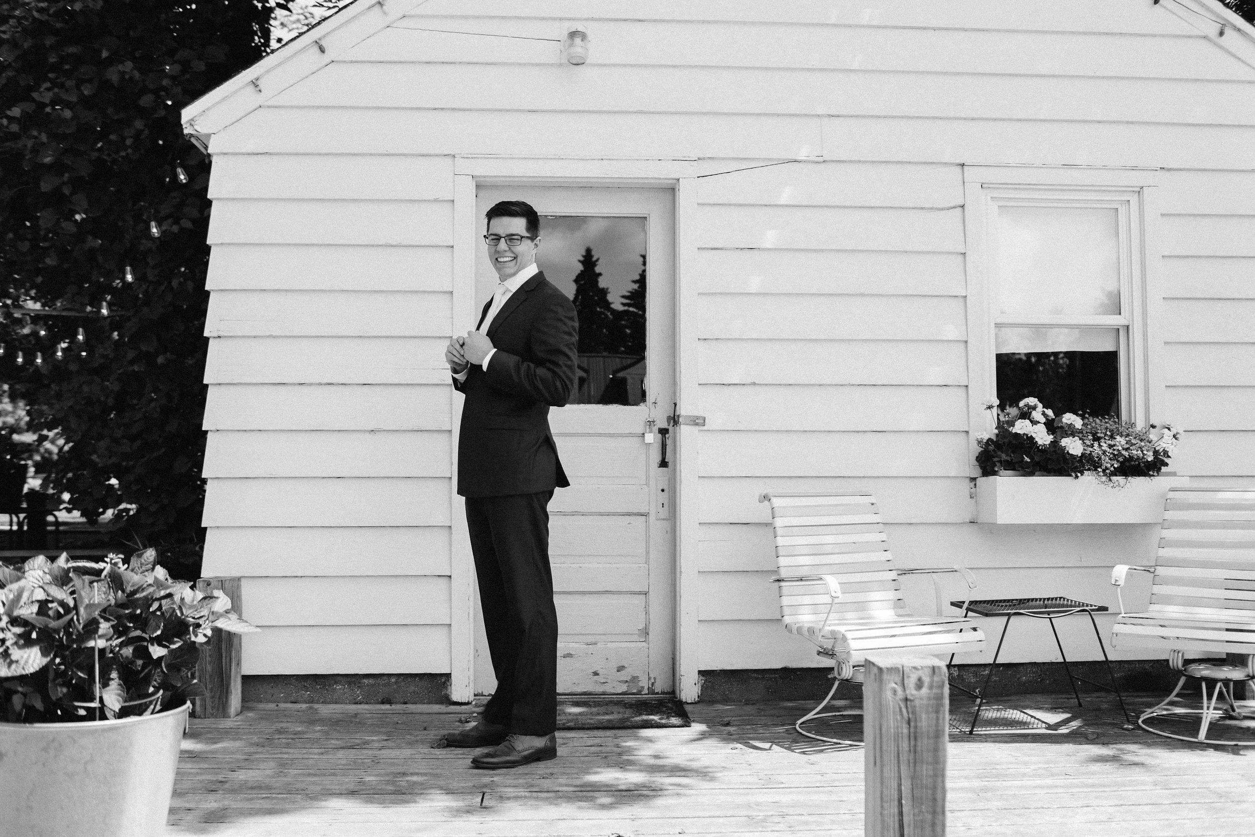outside of cottage jenna mahr black and white.jpg