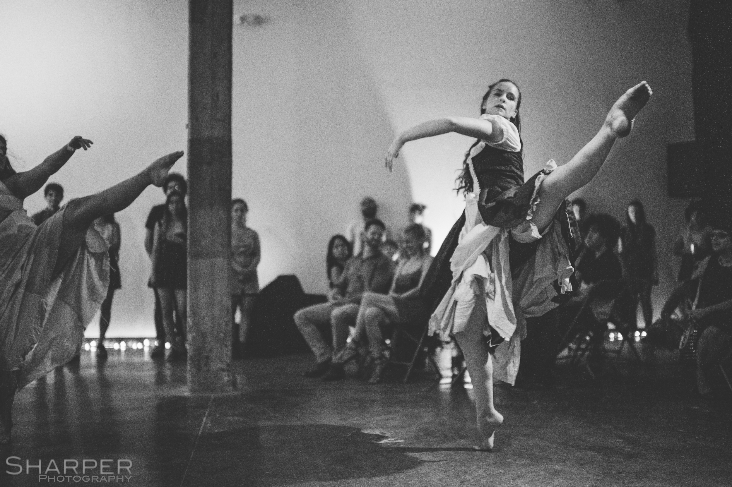 Black and white photo of Shakespeare immersive theater performance in Austin Texas