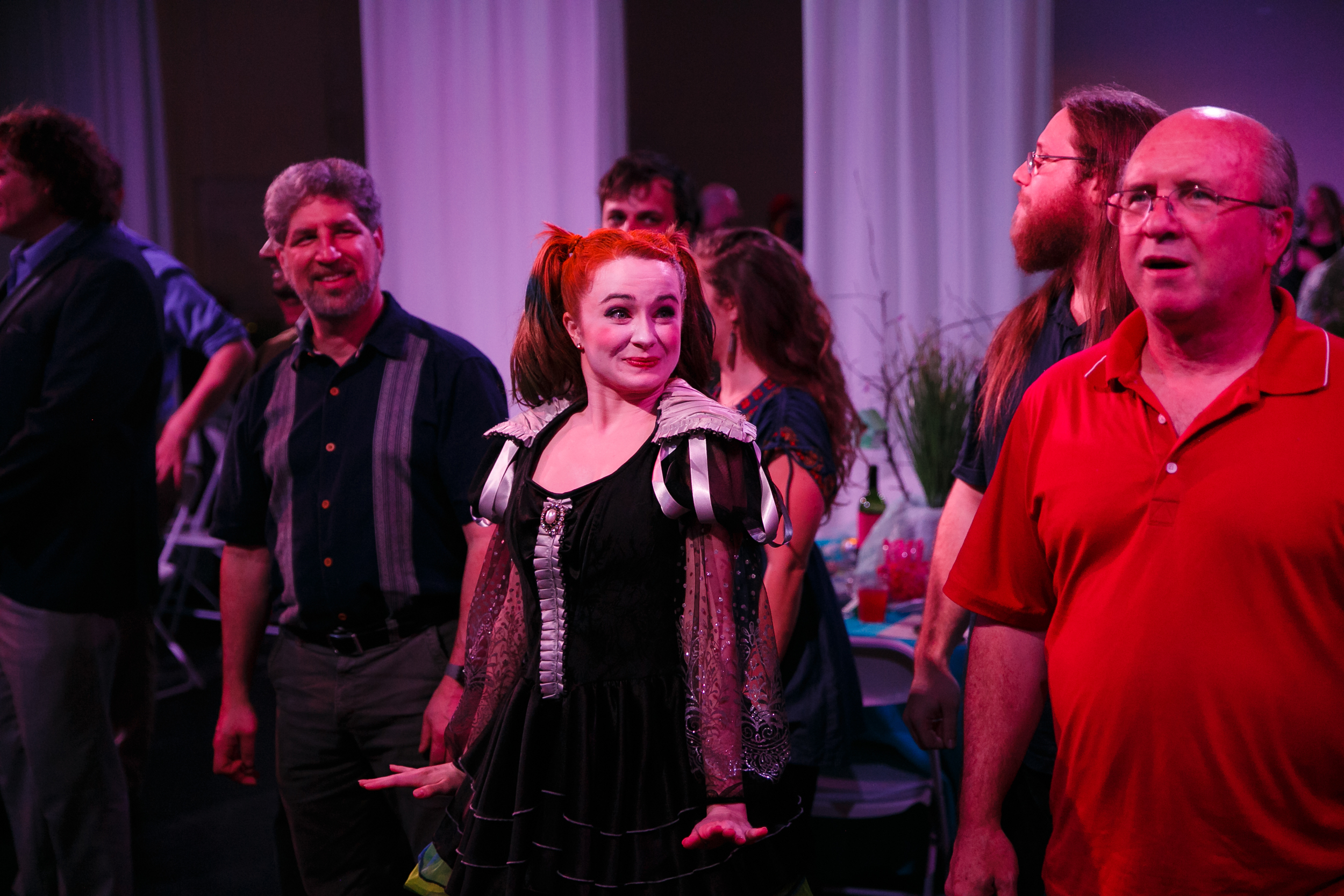 Dancers and audience members interact at 1700s European immersive theater performance in Austin TX