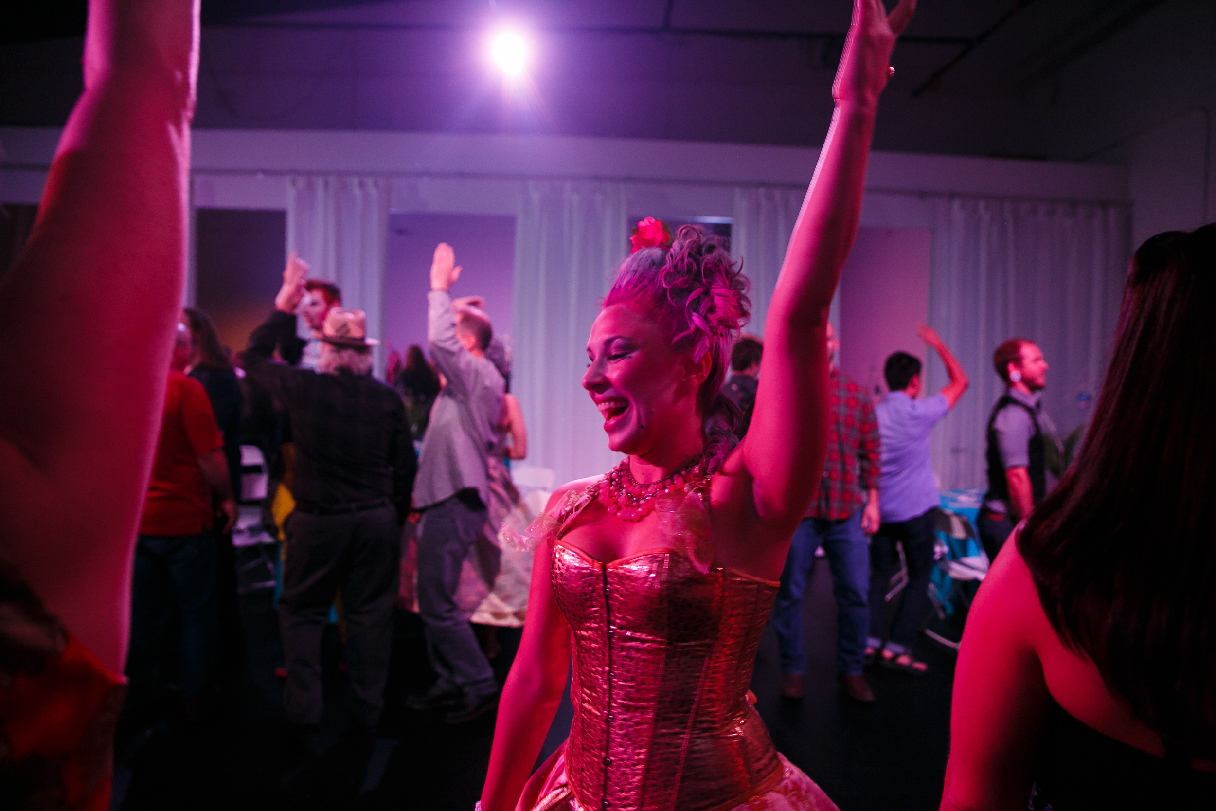 Marie Antoinette-style performer smiles at immersive dance theater show in Austin
