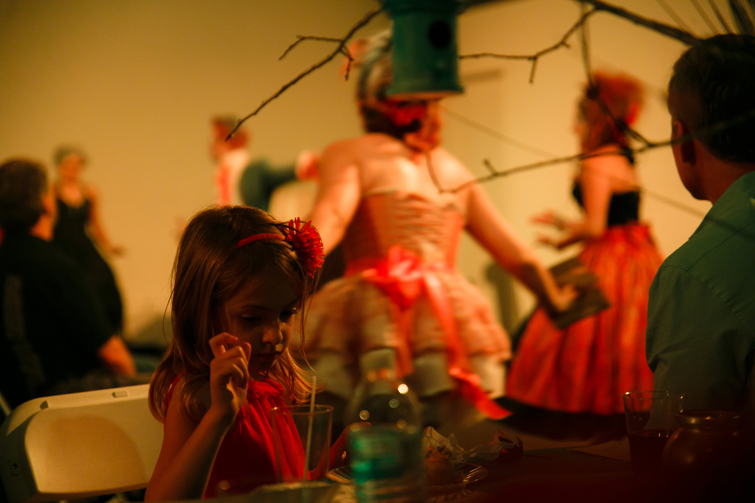 Child watching dancers perform during theater performance in Austin