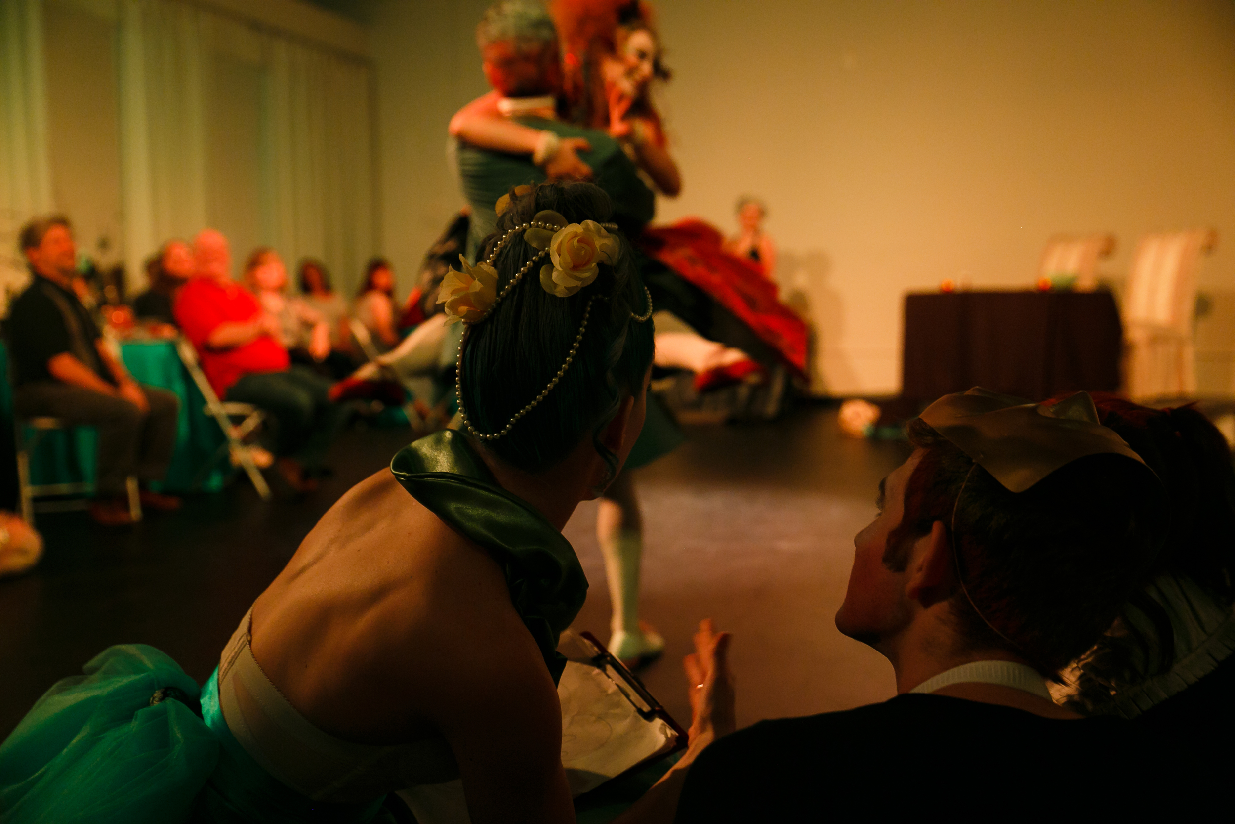 Performer speaks to audience member at immersive dance theater show in downtown Austin Texas