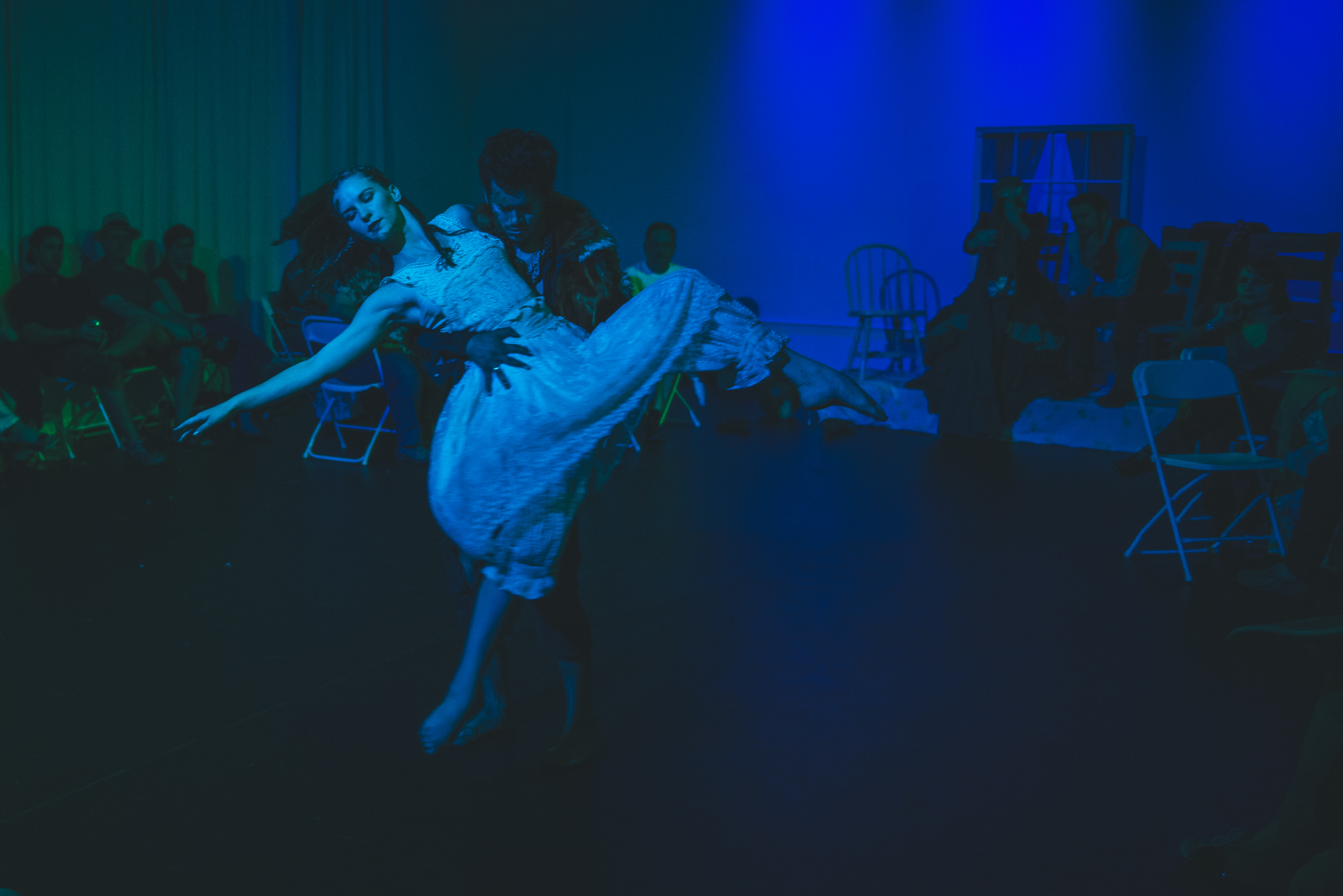 Dancer performing at frontier themed dance theater show