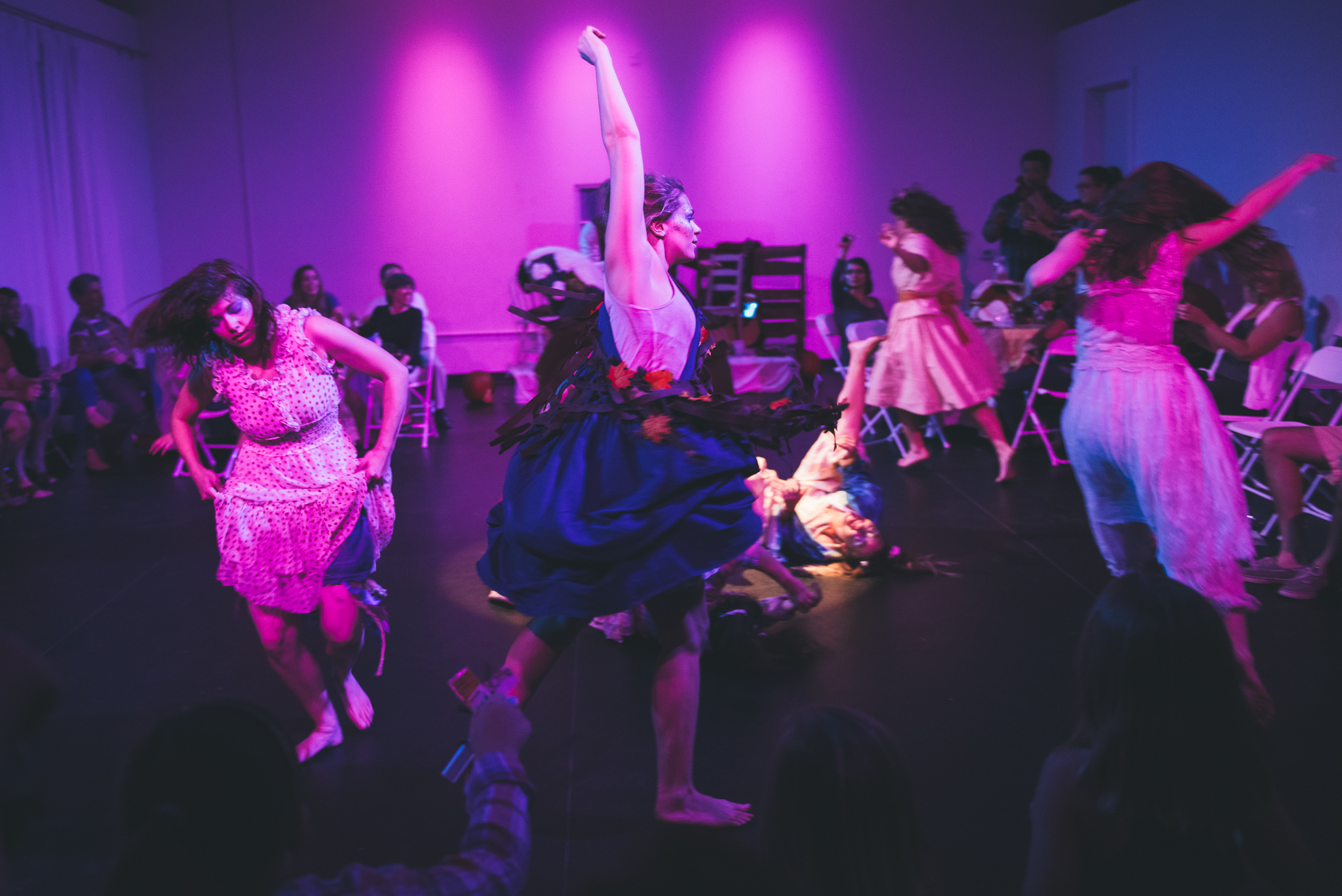 Group dances onstage during immersive theater performance in downtown Austin Texas
