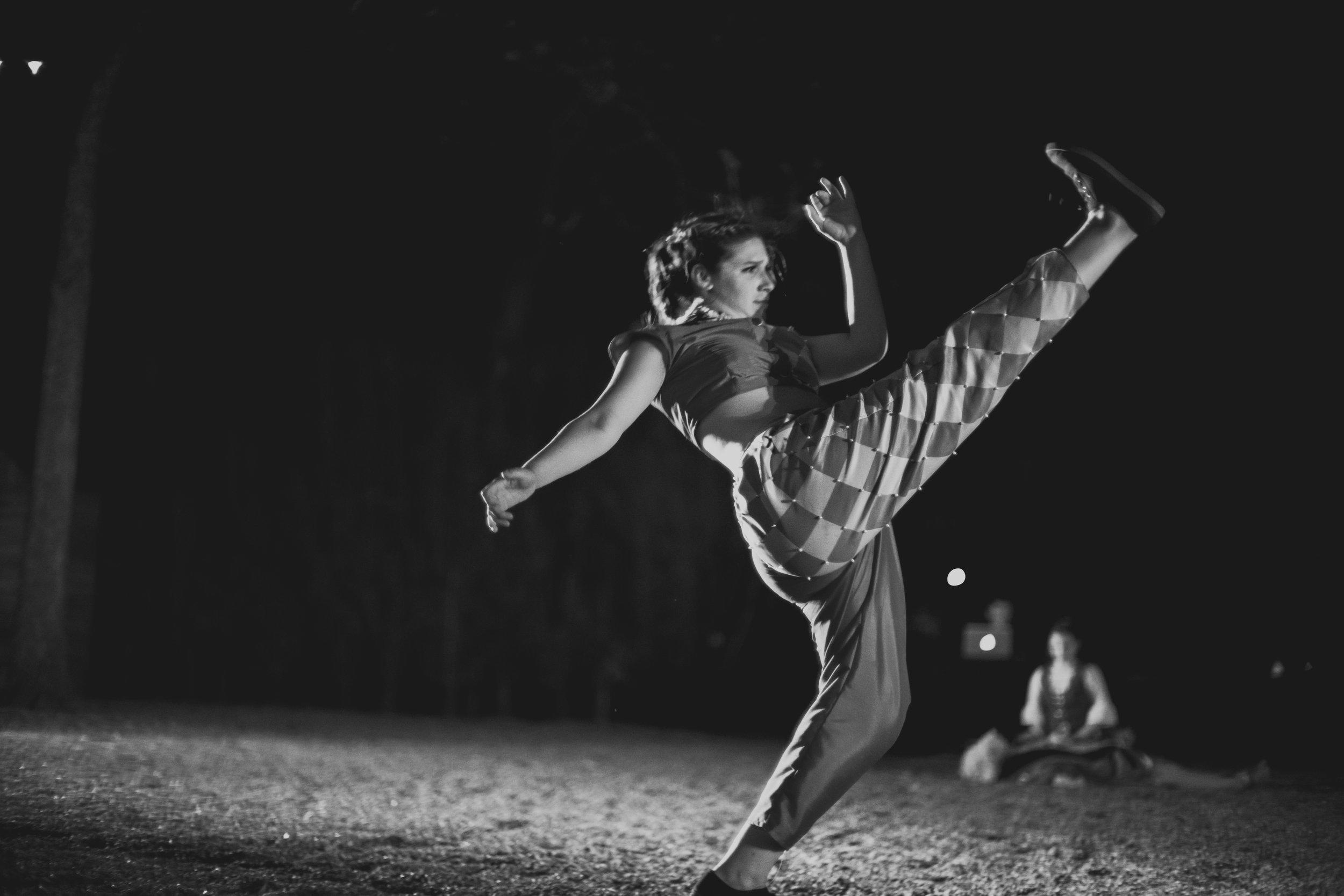 Dancer kicking at Austin event performance