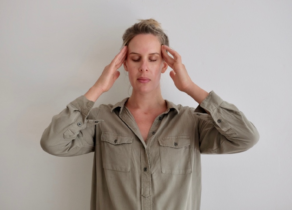 4. Apply pressure to both temples and press gently as you close your eyes. Let your eyes and forehead soften.
