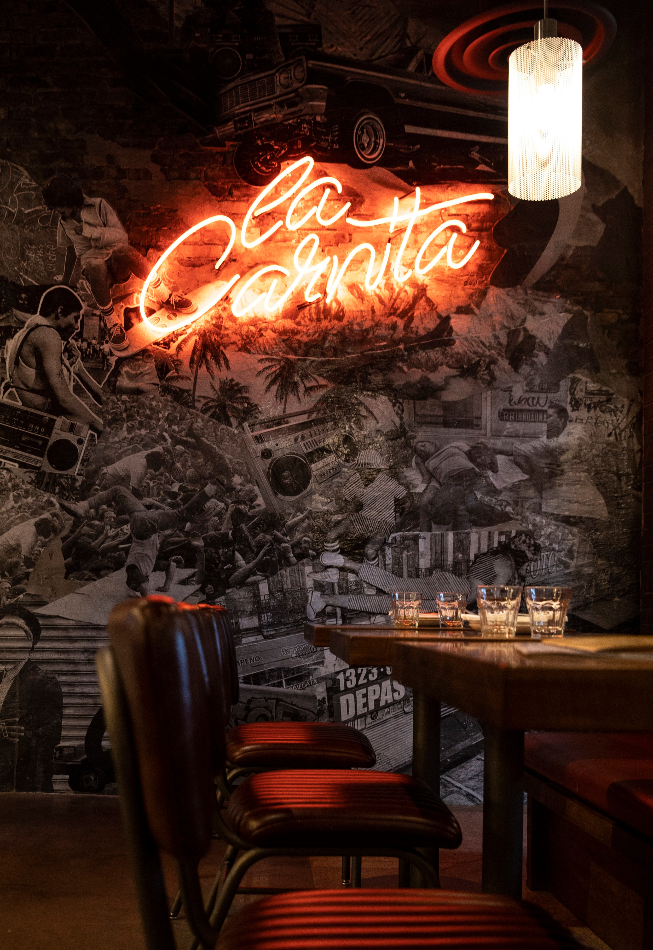 La Carnita SQ1,Toronto - Featuring one of our largest commissions to date, our studio designed and produced an ambitious artwork for the Monarch and Misfits restaurant group. The work is a multi media mobile that hangs from a 40ft ceiling above the main dining room. Alongside our custom mobile, we have curated a mix of accessories and a unique plant wall that features prominently in the newest La Carnita location.