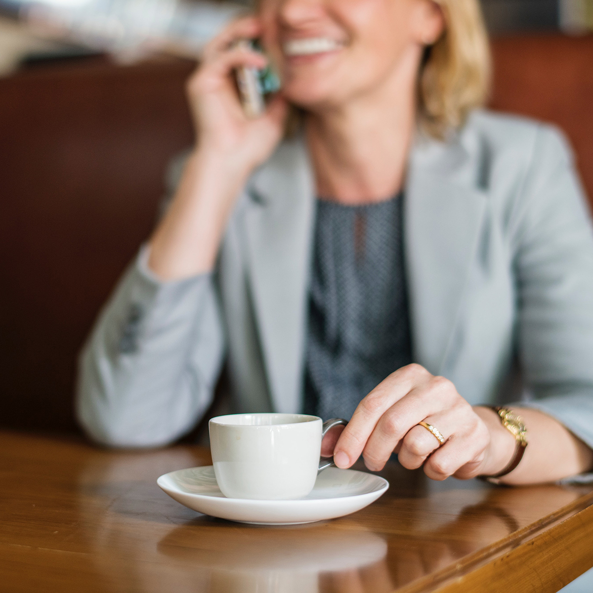 Woman_Drinking_Coffee_Phone_Midwestern_Financial_Fiduciary_Early_Investors.jpg