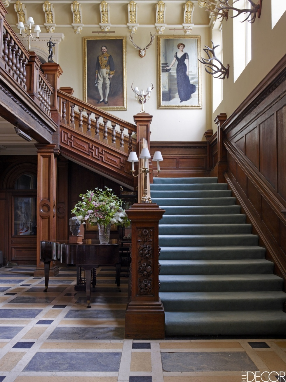 Loving the staircase in this  English Estate . I love the color of the runner against the rich wood.