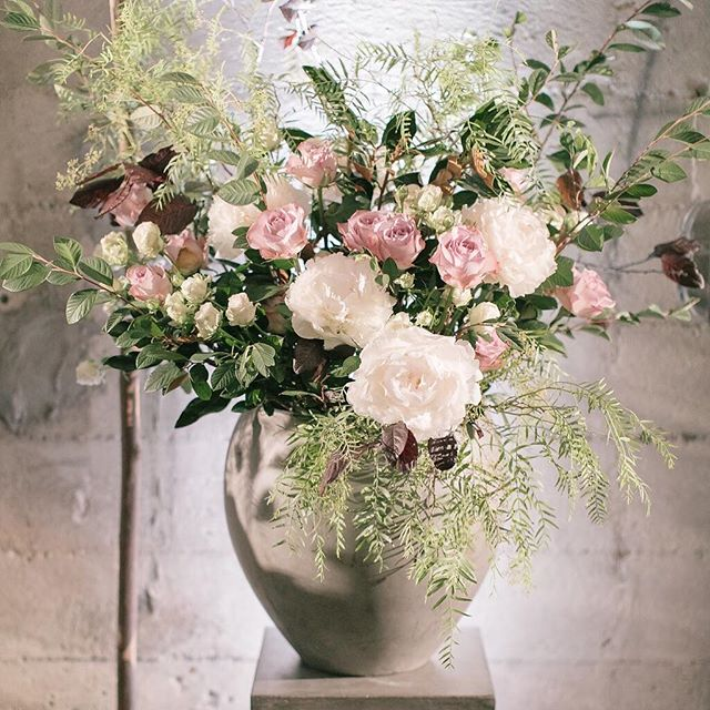 Concrete + Roses, White Light + Fern Photo: @annamarksweddings Floral: @wallflower.design Venue: @foreigncinemasf . . . . #ceremonyflowers #gardenroses #loosearrangement #weddings #sfweddings #foreigncinema