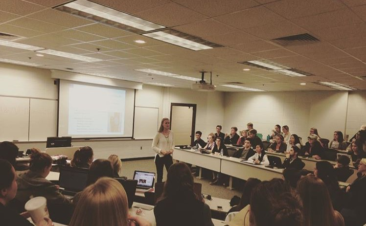 Megan Maloney conducting her final Chapter as PSE-Gamma President.