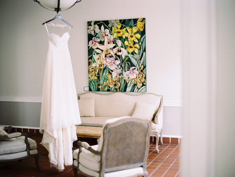 bridal-gown-hanging-in-sitting-room-at-ribault-club.jpg