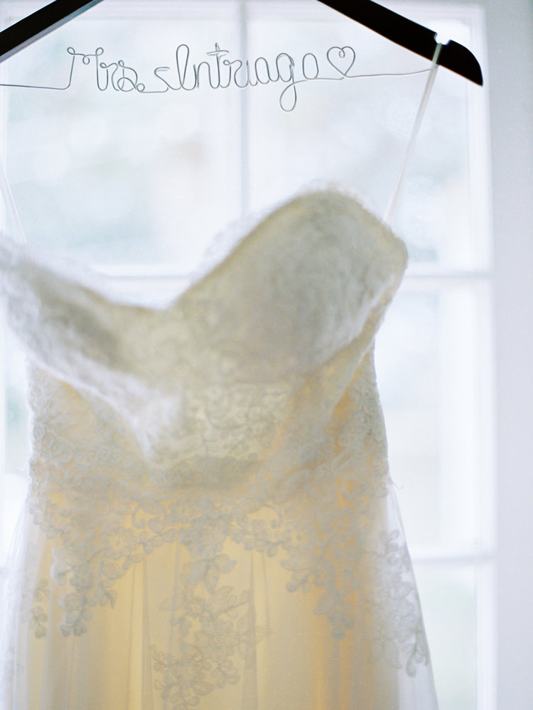 Brides-name-hanger-and-lace-wedding-dress.jpg