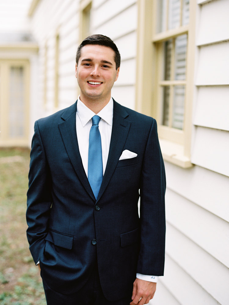smiling-groom-in-blue-suit-ribault-club.jpg