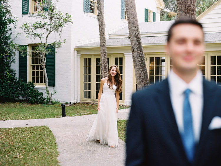 Bride-walking-to-groom-for-first-look-at-Ribault-club.jpg