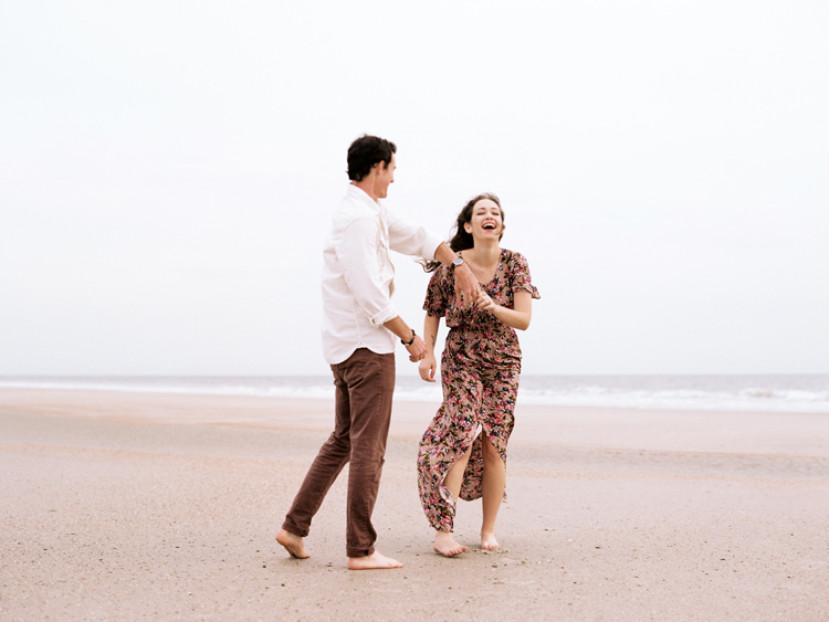 couple-dancing-and-laughing-on-little-talbot-beach.jpg