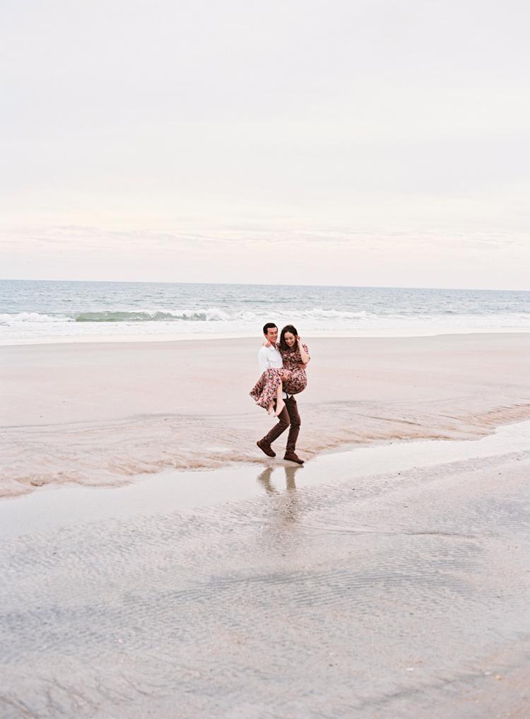 man-carrying-woman-over-water-jacksonville-beach.jpg