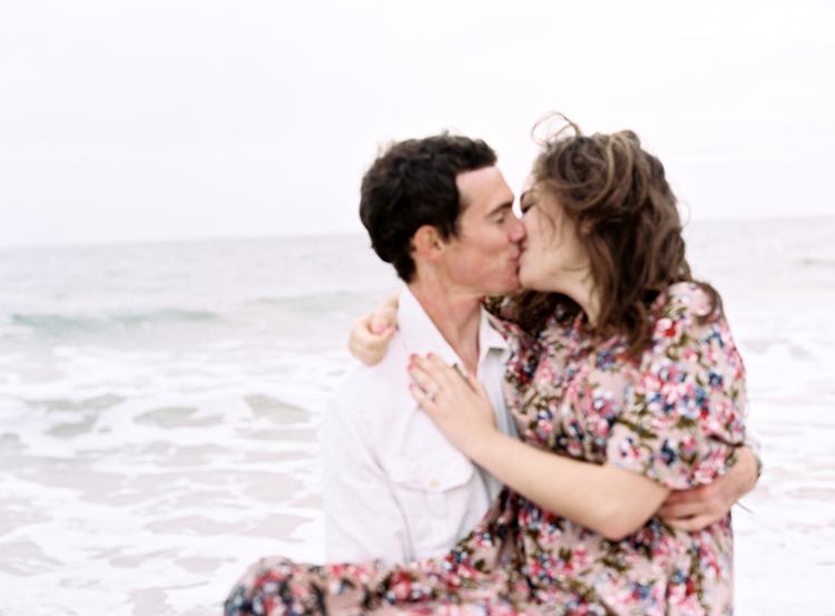 couple-kissing-in-the-ocean-jacksonville-beach.jpg