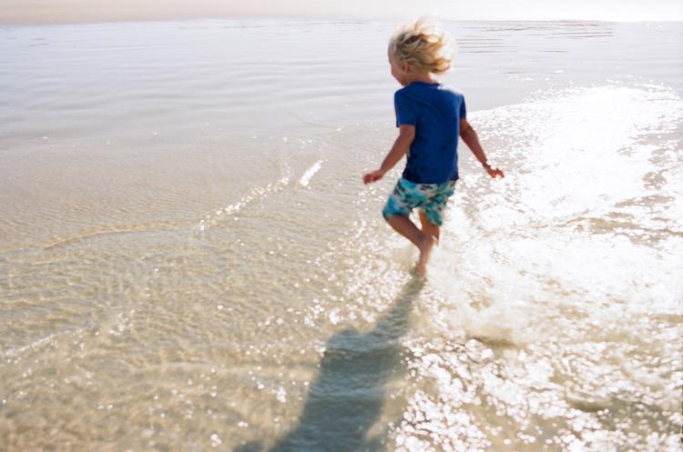 boy-splashing-in-ocean-ormond-beach.jpg