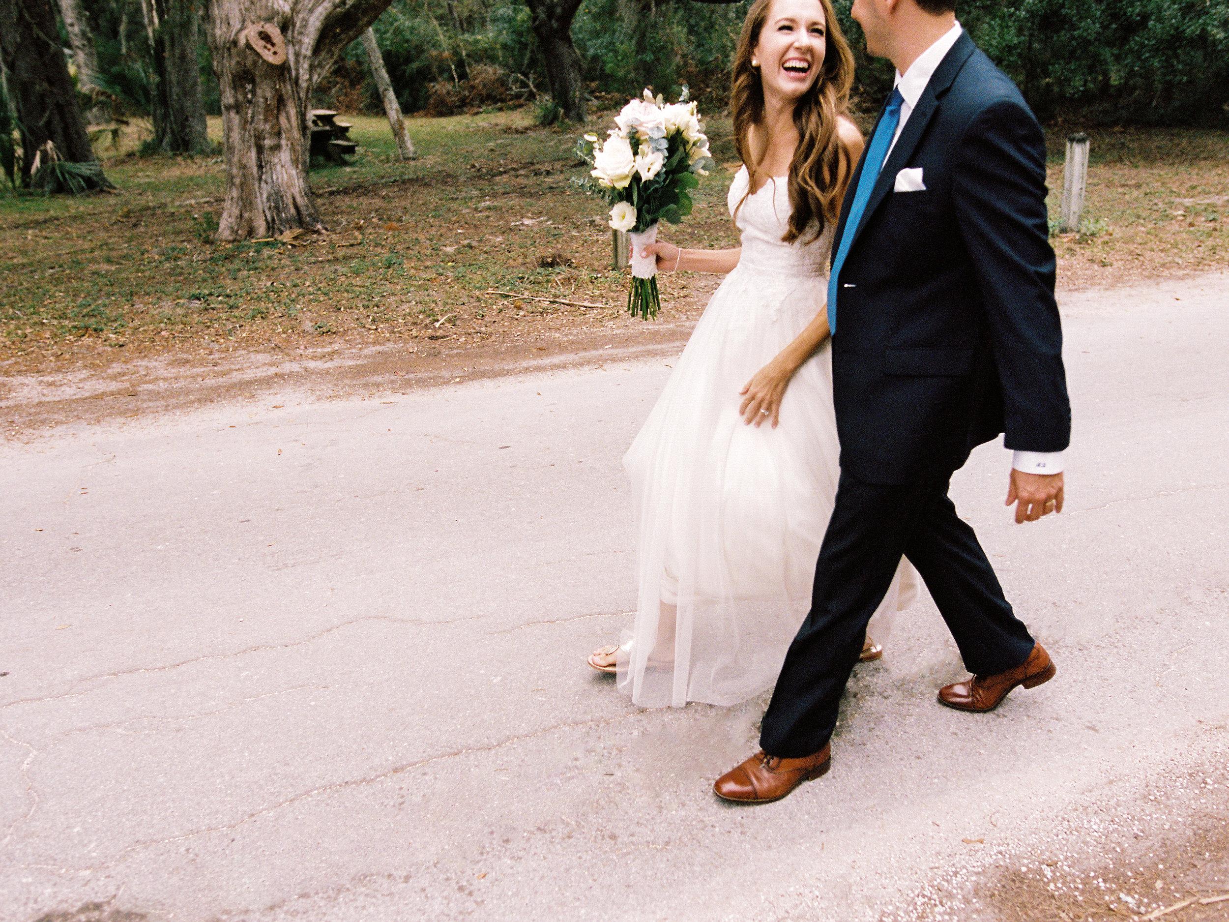 bride-and-groom-talking-and-laughing-ribault-club.jpg