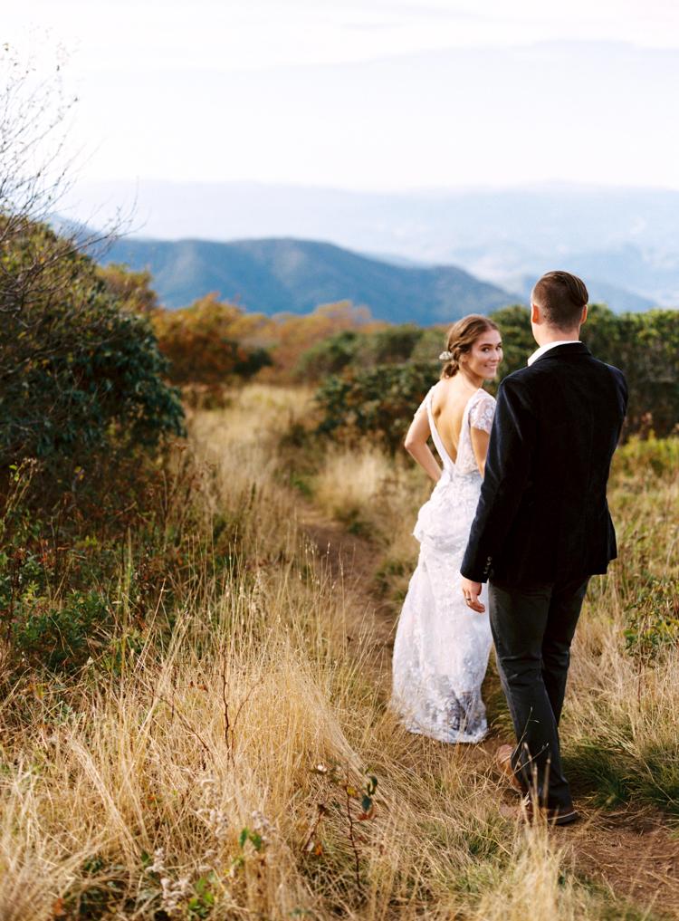 bride-and-groom-exploring-craggy-gardens-wedding.jpg