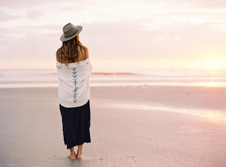woman-watching-sunrise-neptune-beach.jpg