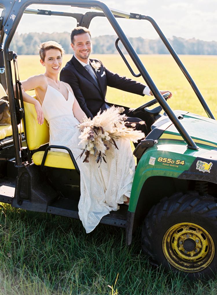 couple-in-tractor-at-florida-farm-wedding.jpg