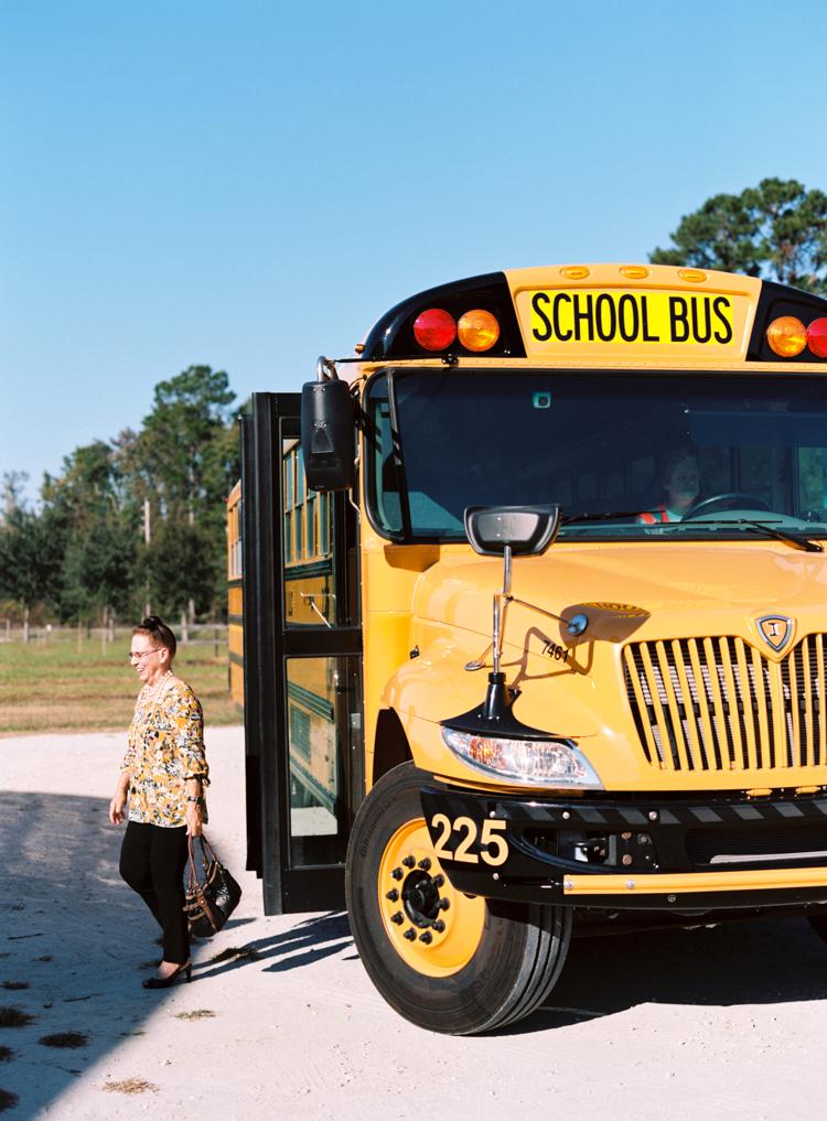 guests-arrive-on-school-bus-florida-wedding.jpg