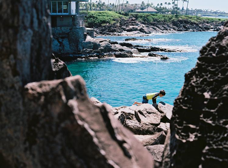 boy-climbing-on-rocks-lahaina-maui.jpg