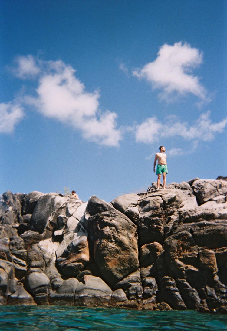 Man-standing-on-sea-cliffs-lahaina-hawaii.jpg