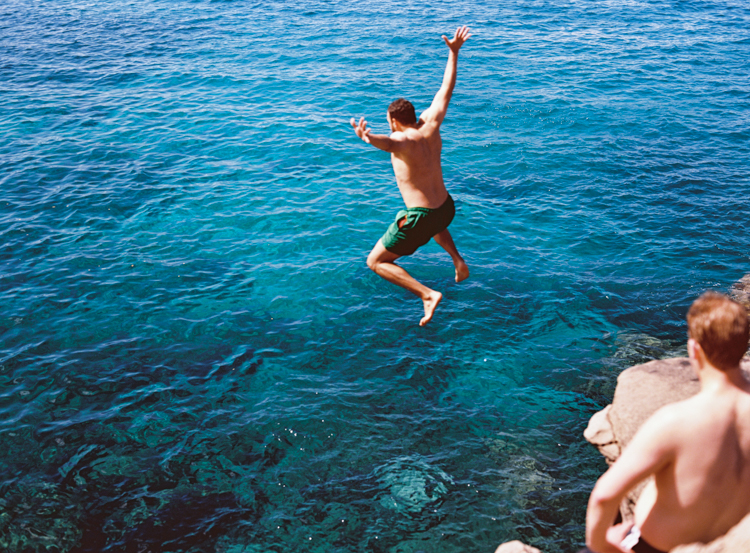 man-cliff-jumping-into-ocean-lahaina-hawaii.jpg