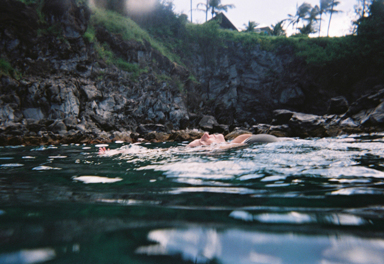 woman-floating-in-ocean-lahaina-hawaii.jpg