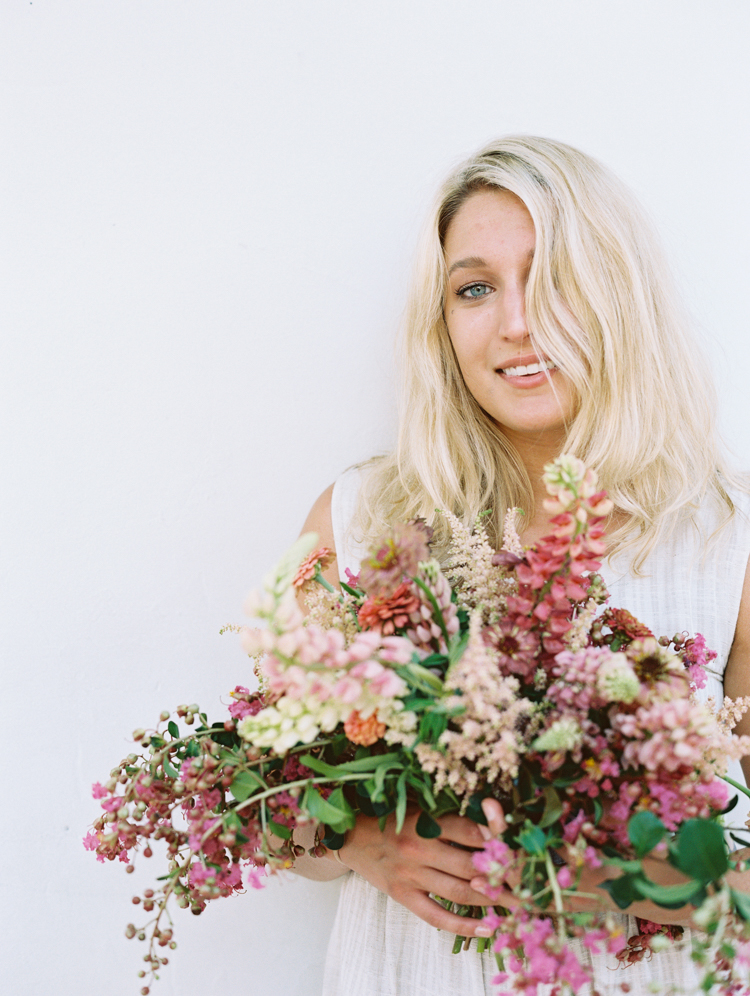 Blonde woman with large pink bouquet