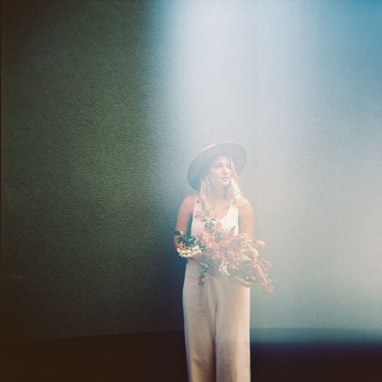 Film image of woman with bouquet