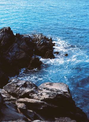 black cliffs in the ocean in maui