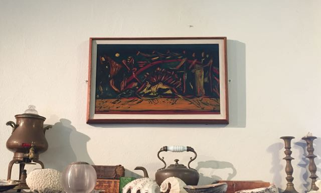 "The only original Pollock painting in the house is this small 1938 painting, ""Composition with Red Arc and Horses"" which alludes to Pollock's study of Native American Art and Orozco."