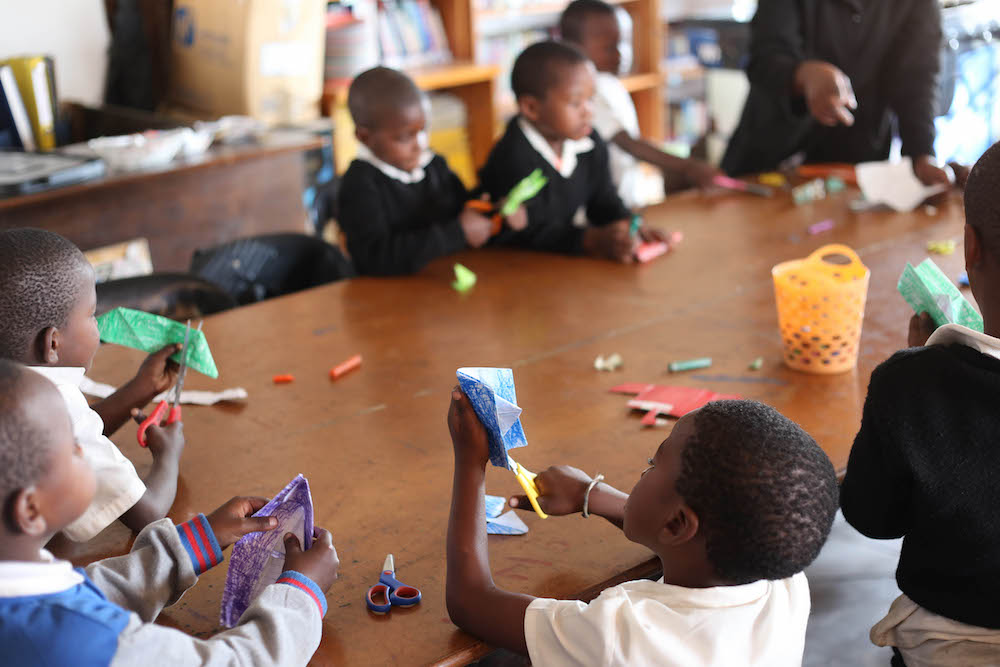 after-school education  Our model makes use of local resources: sessions take place in empty classrooms and local youth are trained to become educational facilitators. At the start of every after-school session, children are given a nutritious meal prepared by our cooks at our sustainable Community Centre.  With Thanda, learning is fun. We approach education by looking at thematic elements from philosophers such as Plato, artists such as Ai Weiwei, and superheroes such as Ironman as a lens for analyzing traditional belief systems, cultural identities, and active citizenship. Our Creative Learning Curriculum is built around stories, which are used to broaden horizons, make lateral connections across subject areas, link global issues to the local community, and cultivate five essential skills: self-esteem, critical thinking, empathy, rebelliousness, and creativity.