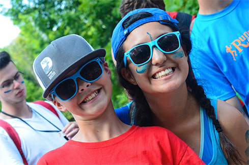 Camper James smiles with counsellor Claire during a theme-day competition at Camp Banting in Ontario.   SUPPLIED
