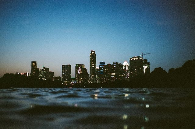 austin city skyline on the 4th of july, as seen from a kayak (on film) // leica m4 w/ portra 400