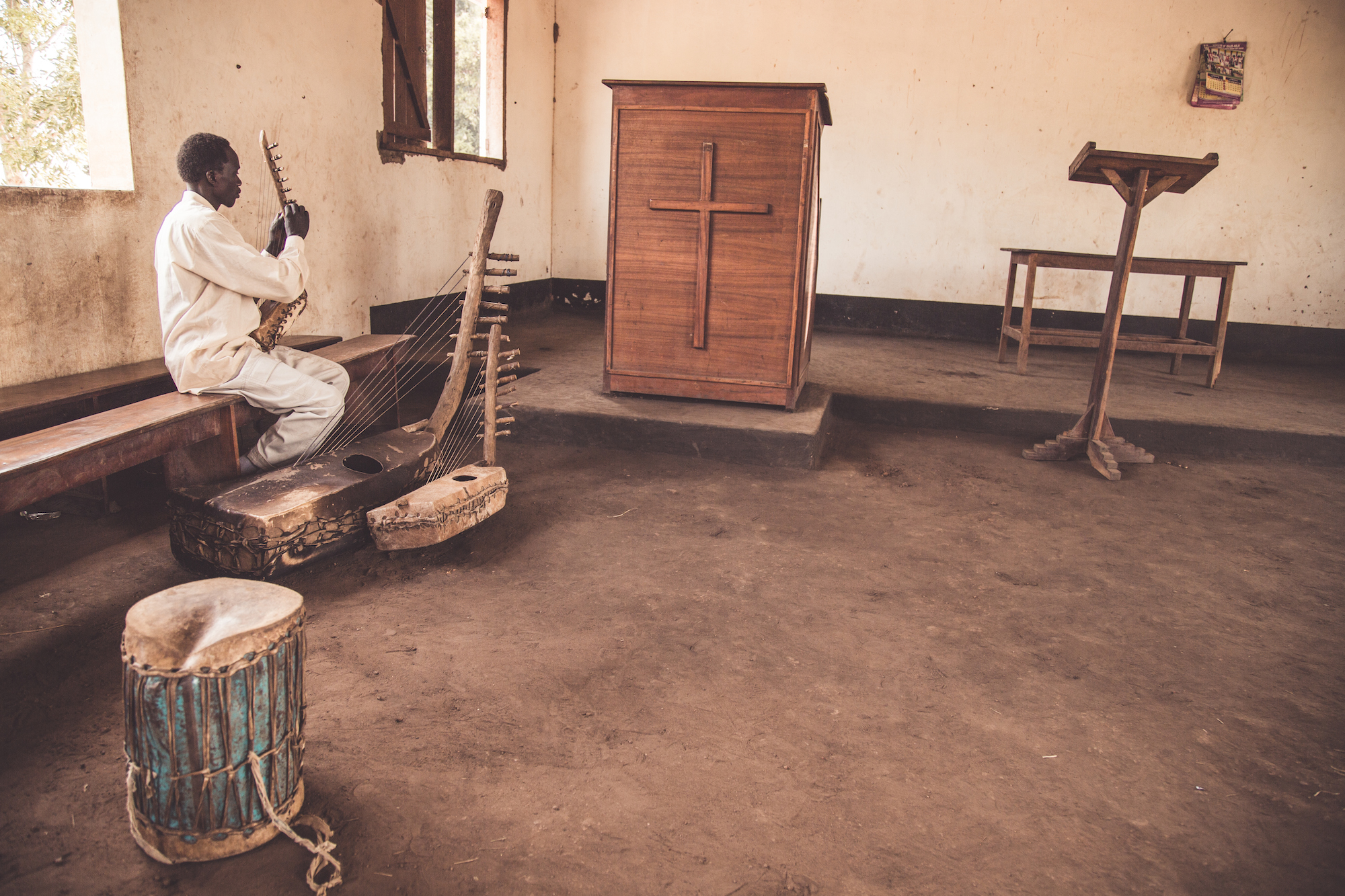 Tuning the local instruments before mass at church in Kala.