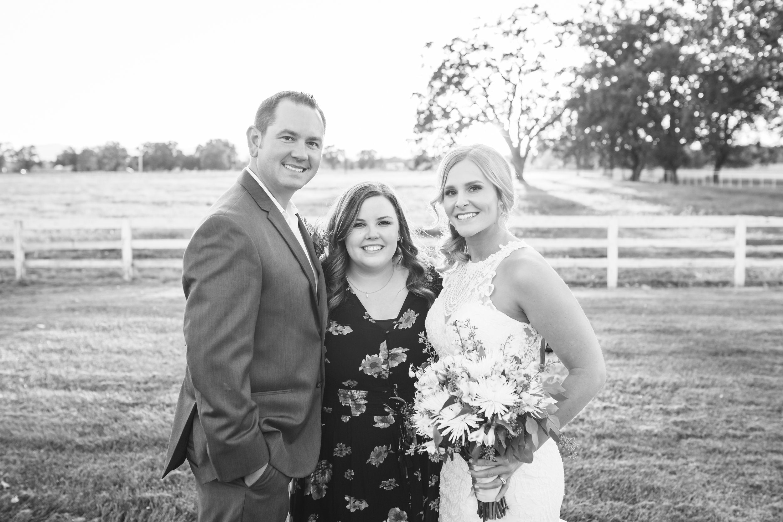 Even the photographer gets a photo with the bride and groom!