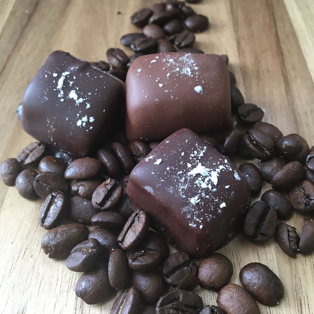 Coffee Caramel - Nolia caramel infused with our special blend of coffee and topped with a dash of powdered sugar. A perfect accompaniment to your afternoon coffee break! Available in milk or dark chocolate