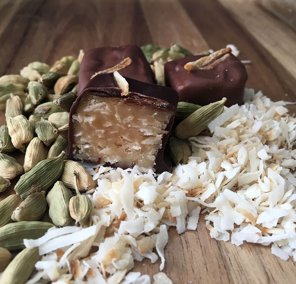 Coconut Cardamon Caramel - Nolia's freshmade caramel mixed with shredded coconut and a touch of ground cardamon in milk or dark chocolate.
