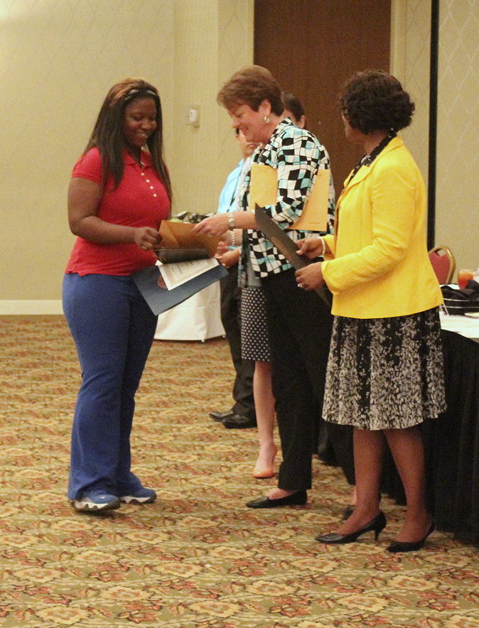 Danasjia Horsley accepts the first-ever GoodGuides Mentee of the Year Award.